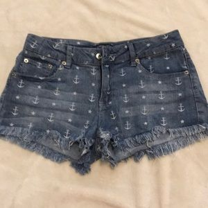 Anchor and star ripped jean shorts